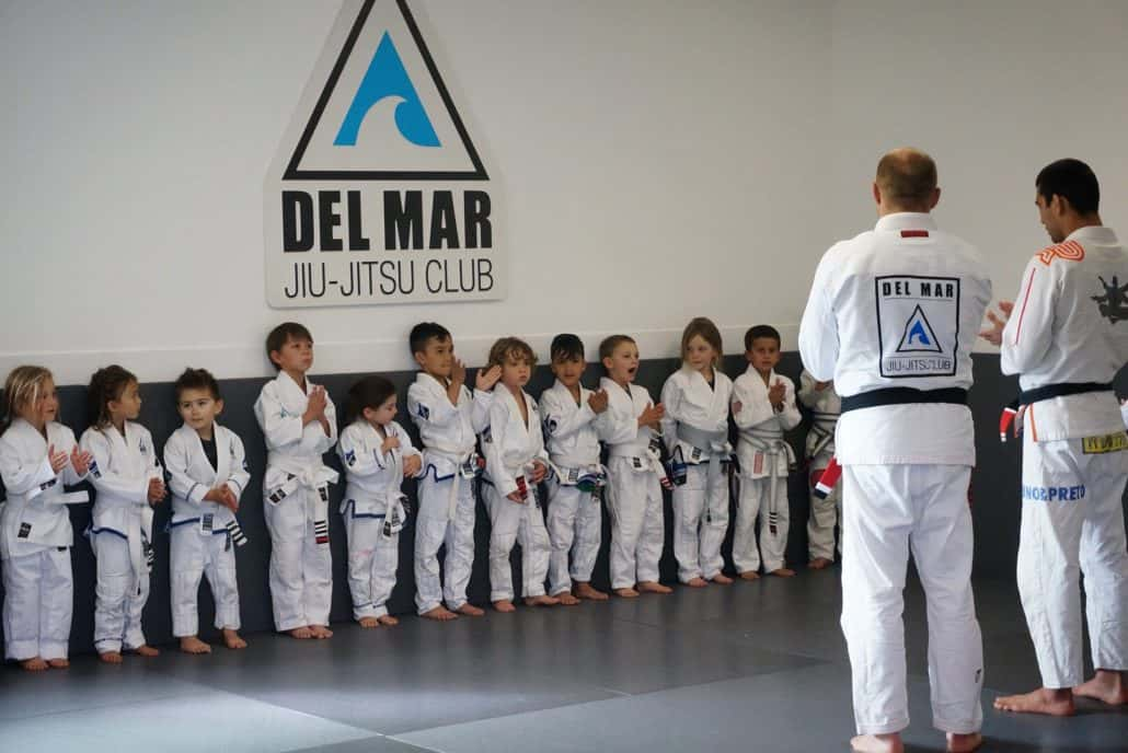 students line up for instruction during kids jiu-jitsu class in San Diego