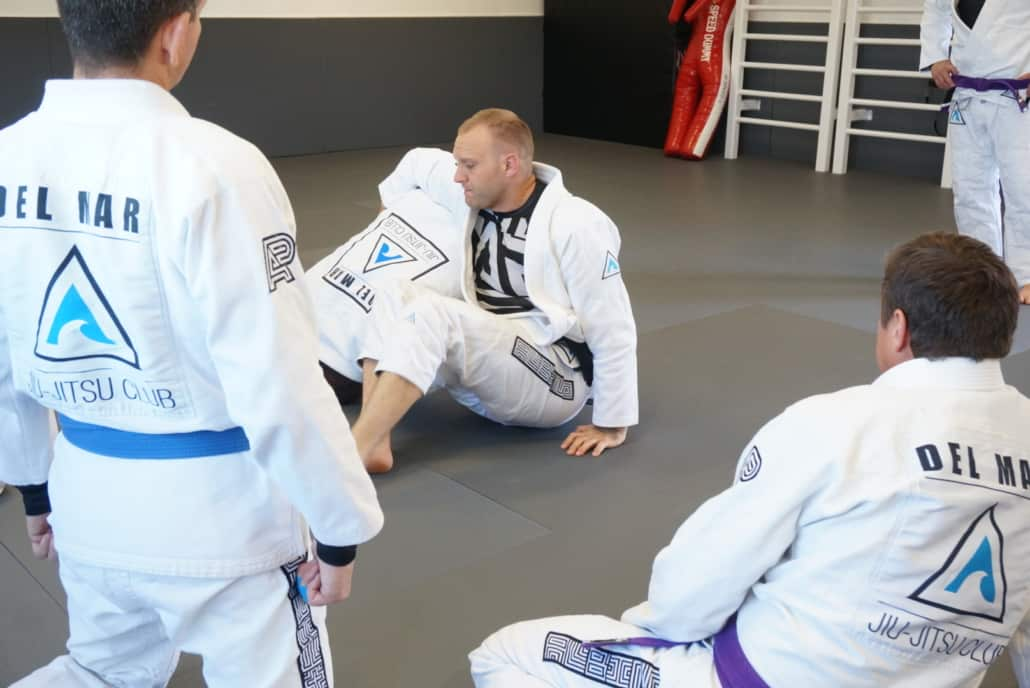 Instruction and example during adult jiu-jitsu class