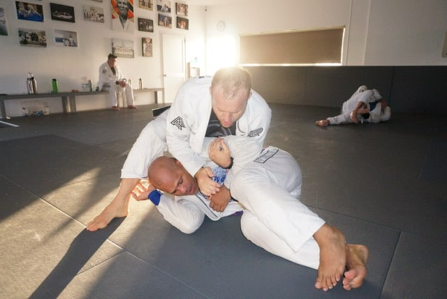 advanced jiu-jitsu class with belt black instructor