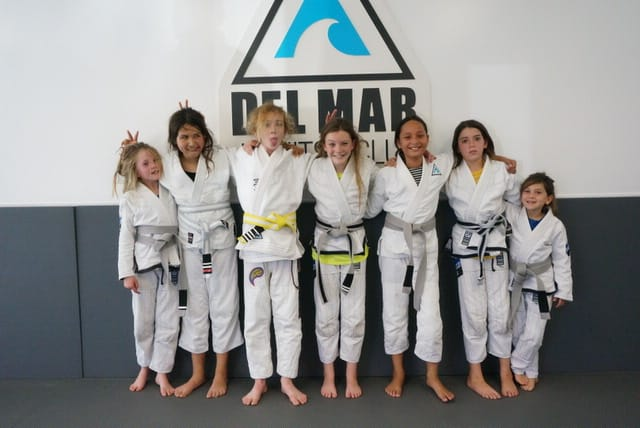 kids jiu jitsu for kids 9 and older pose for photo