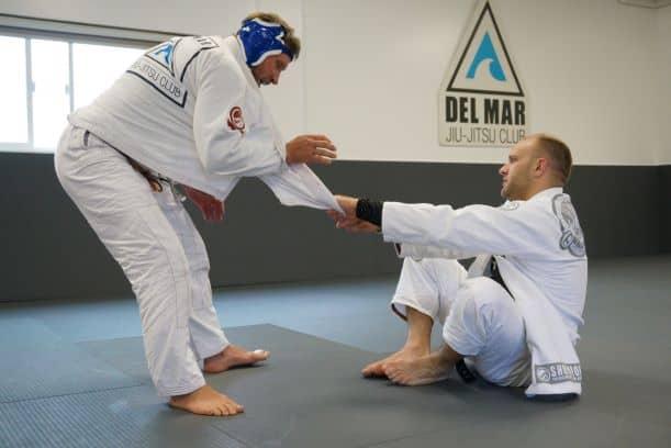 black belt coach gives a private jiu-jitsu lesson