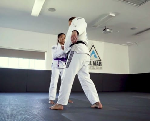 jiu-jitsu student learns basic self defense with a collar grab escape