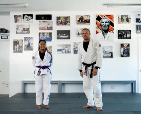 jiu-jitsu student and instructor prepare for self defense training