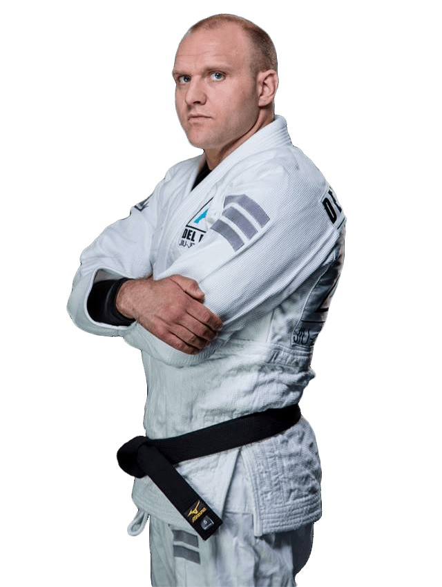 Jiu-Jitsu coach confident with black belt